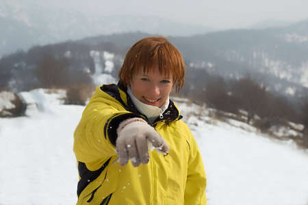 Young woman play in snowball photo