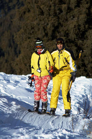 Yong family skiers in yellow rise on ski lift photo