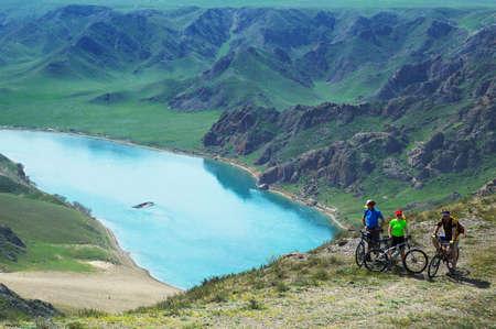 Adventure mountain biking on riverside Stock Photo