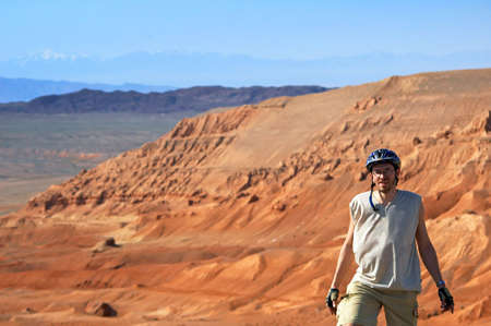 Mountain biker on red canyon photo
