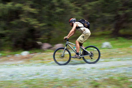Speed motion mountain biker Stock Photo - 2761867