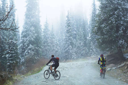 crosscountry: Two bikers in spring mountains