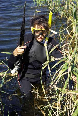 skin diving: Underwater fisherman girl in the lake