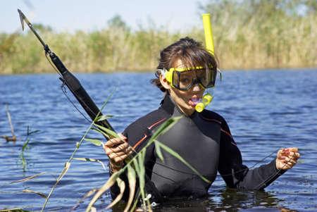 Underwater fisherman girl in the lake
