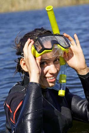 skin diving: Underwater diver girl in lake Stock Photo