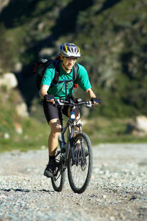 crosscountry: Mountain biker on country road