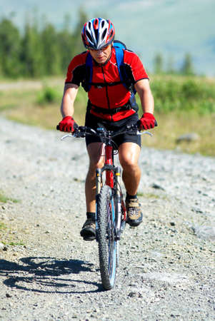 Mountain biker on country road Stock Photo - 3562084