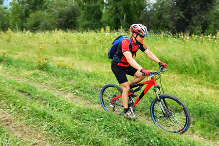 Mountain biker on rural road Stock Photo - 3562043