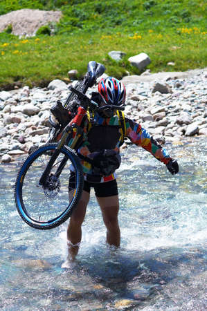 crosscountry: Biker and mountain river Stock Photo