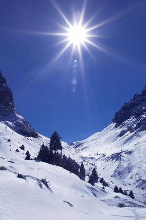 sun track: Bright sun in winter mountains