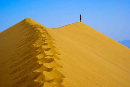 Man on top Sand Dune photo