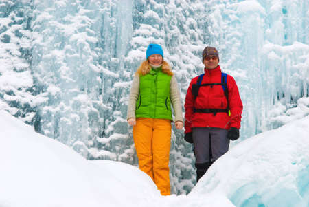 Couple backpackers and ice waterfall Stock Photo - 3760141
