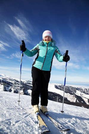 Ski woman on mountain resort photo