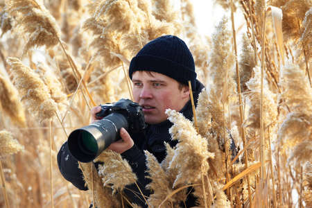 Nature Photographer shooting in winter cane field photo