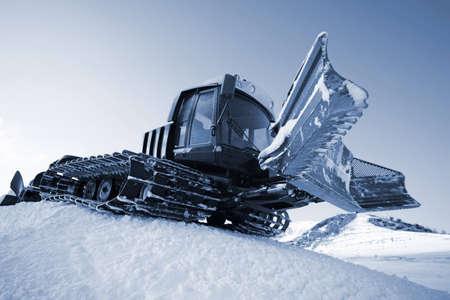 Piste machine (snow cat) - preparation ski slope photo