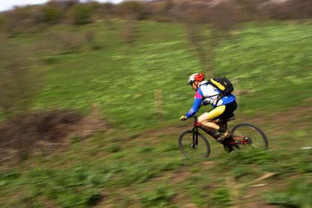 Speed motion biker in spring mountains photo