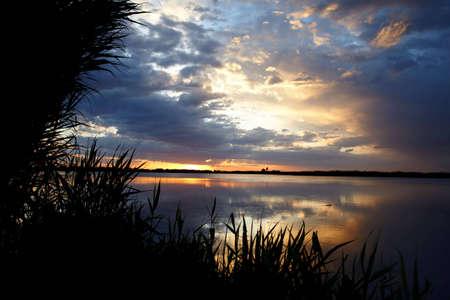 Sunrise on like and clouds photo