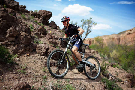 Mountain biker in wild desert canyon photo