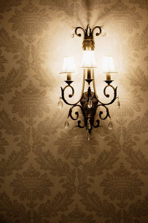 Stylish lamp on the wallpaper Stock Photo - 7024539