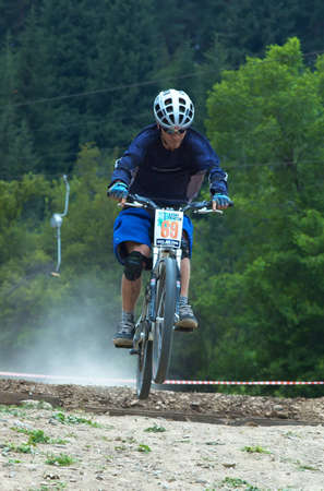 bikecross: ALMATY, KAZAKHSTAN - JULY 3: Andrey Davydenko (no. 69) in action at Kumbel Hotel Hasa Cup 2005 bike cross competition in Almaty, Kazakhstan July 3, 2005