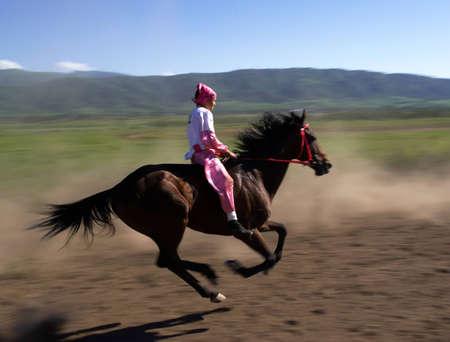 "LEPSINSK, KAZAKHSTAN - JUNE 14 : A traditional national nomad long-distance horse riding competition ""Bayga"" in action on June 14, 2008 in Lepsinsk, Kazakhstan."