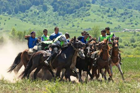 LEPSINSK, KAZAKHSTAN - JUNE 14 : A traditional nomad game of �Kokpar� in action on June 14, 2008 in Lepsinsk, Kazakhstan. Kokpar is played on horseback to carry dead goat carcass into a goal.