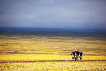 ALMATY, KAZAKHSTAN - MAY 2:V.Skorobogatov (N5),A.Pomortcev (N25) and K.Babin (N3) in action at Adventure mountain bike cross-country marathon in mountains