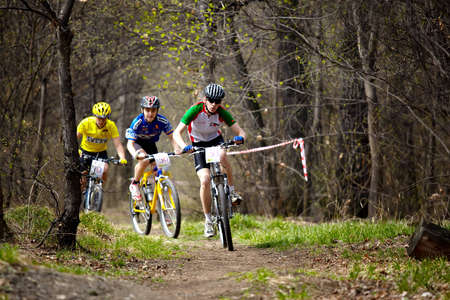 bikecross: ALMATY, KAZAKHSTAN - April 5: Ivan Korolev (N53) and Stas Plisuchenko (N56)  in action at cross-country relay race in Almaty, Kazakhstan April 5, 2009.