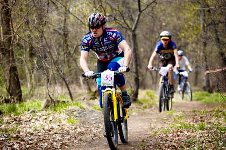 bikercross: ALMATY, KAZAKHSTAN - April 5: Rashit Nurjanov (N35)  in action at cross-country relay race in Almaty, Kazakhstan April 5, 2009. Editorial