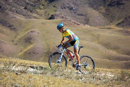 ALMATY, KAZAKHSTAN - SEPTEMBER 13: Kirill Kazantcev (N32) in action at Adventure mountain bike cross-country marathon in mountains