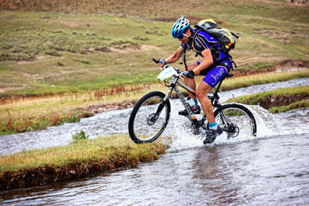 ALMATY, KAZAKHSTAN - SEPTEMBER 13: Ivan Popov (N7) in action at Adventure mountain bike cross-country marathon