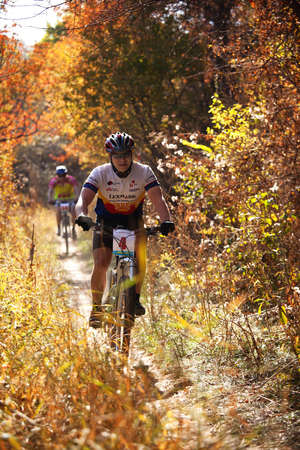 ALMATY, KAZAKHSTAN - OCTOBER 18: Igor Baranov (N4) in action at cross-country mountain bike 'Apple race' October 18, 2009 in Almaty , Kazakhstan. Stock Photo - 7007240