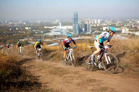 ALMATY, KAZAKHSTAN - OCTOBER 18: Riders in action at cross-country mountain bike Apple race October 18, 2009 in Almaty , Kazakhstan.