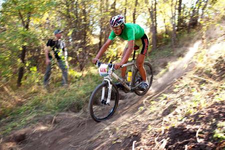 ALMATY, KAZAKHSTAN - OCTOBER 18: Nurbolat Kulimbetov in action at cross-country mountain bike Apple race October 18, 2009 in Almaty , Kazakhstan.
