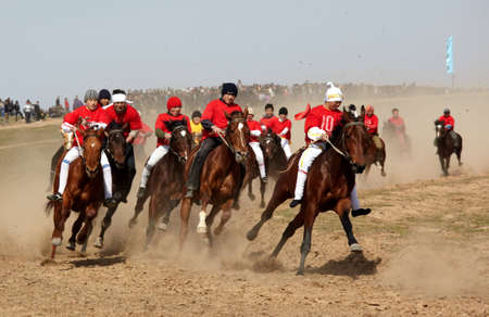 AKCHI, KAZAKHSTAN - MARCH 22 : A traditional national nomad long-distance horse riding competition �Bayga� in action on MARCH 22, 2009 in Akchi, Kazakhstan.