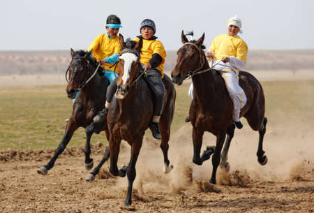 """AKCHI, KAZAKHSTAN - MARCH 22 : A traditional national nomad long-distance horse riding competition """"Bayga"""" in action on MARCH 22, 2009 in Akchi, Kazakhstan."""