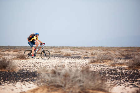 ALMATY, KAZAKHSTAN - MAY 1: V.Kochetov (N26) in action at Adventure mountain bike marathon in desert
