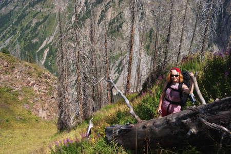hight: Woman hiking in hight mountain