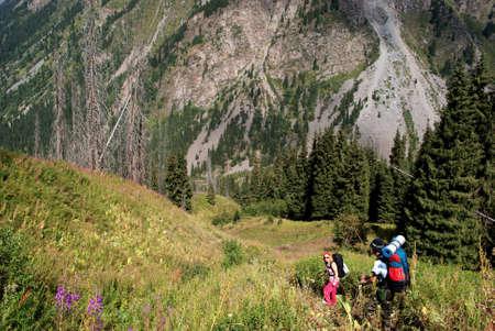 Couple hiking in hight mountain photo