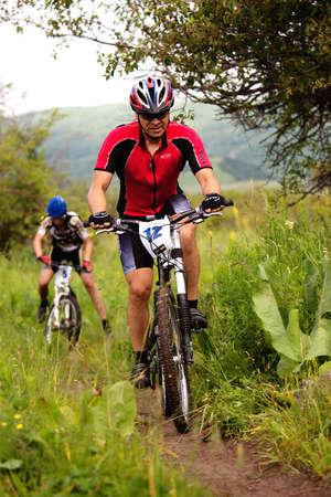 ALMATY, KAZAKHSTAN - JUNE 20: I.Baranov (N12) in action at Adventure mountain bike cross-country competition Ak Bulak 2010 June 20, 2010 in Almaty, Kazakhstan