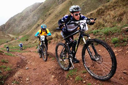 ALMATY, KAZAKHSTAN - MAY 2: M.Kolbasov (N24) in action at Adventure mountain bike cross-country marathon in mountains