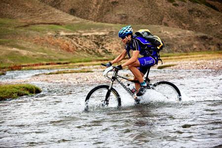 ALMATY, KAZAKHSTAN - SEPTEMBER 13: Ivan Popov (N7) in action at Adventure mountain bike cross-country marathon