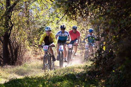 ALMATY, KAZAKHSTAN - OCTOBER 18: Sergey Boronin(N2) and other in action at cross-country mountain bike 'Apple race' October 18, 2009 in Almaty , Kazakhstan. Stock Photo - 8150204
