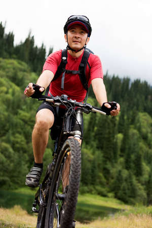 Asian mountain biker in summer mountain Stock Photo - 8308560