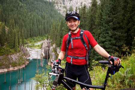 Asian mountain biker in summer mountain photo