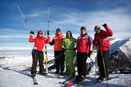 Group of friends, enjoying at mountain ski resort photo