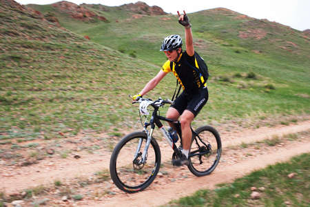 ALMATY, KAZAKHSTAN - MAY 1: V.Marchenko (N27) in action at Adventure mountain bike cross-country marathon in mountains