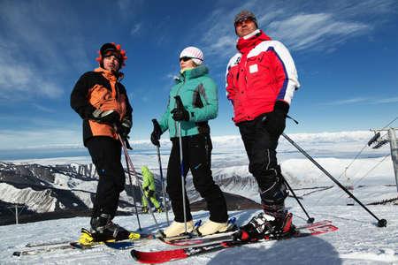 Group of friends, enjoying at mountain ski resort photo