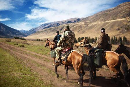 Horseback Riding in the Kazkahstan mountain Stock Photo