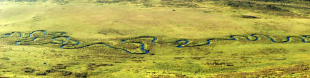 Panoramam of curved river on meadow in Altai mountains, Kazakhstan photo